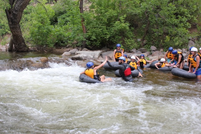 Group river tubing on clear creek river by Golden Colorado